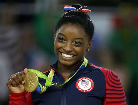 Olympic champ Simone Biles says she was abused by Larry