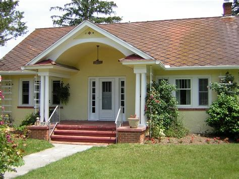 Cottage House with a Stucco Exterior Painted Yellow in